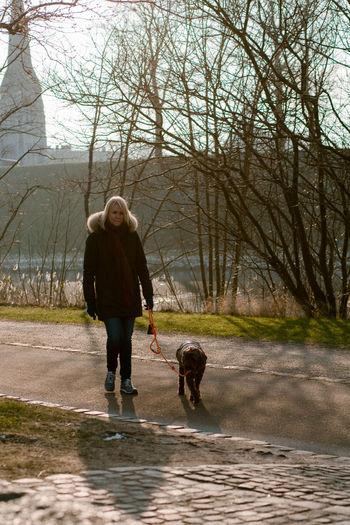 Full length of man walking with dog