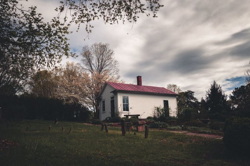 To the countryside. Cemetery Building Exterior Building Moody Outdoors Outdoor Photography Tree Sky Grass Building Exterior Historic Exterior Yard