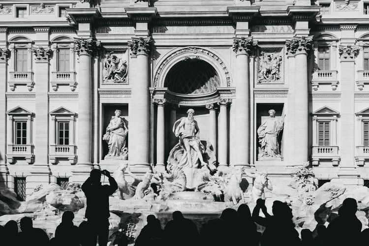 People taking picture of trevi fountain