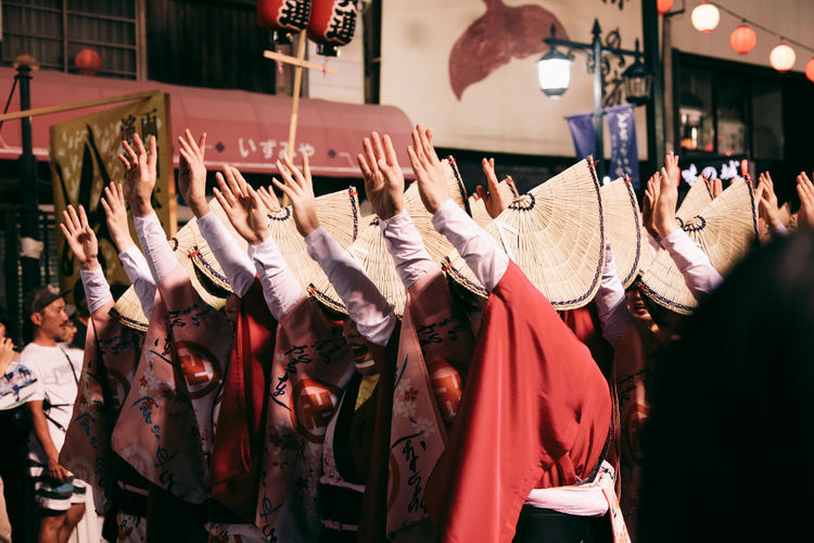 Women Dancing With Arms Raised During Awa Dance Festival