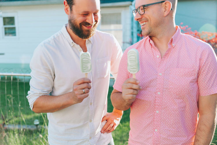 Two men laughing and eating ice cream. Happiness Two People Emotion Smiling Togetherness Men Leisure Activity Fun Bonding Ice Cream Treats Laughing Summer