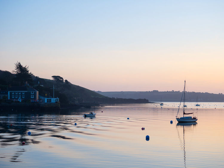 Sunrise over Falmouth in Cornwall, UK Calm Morning Olympus OM-D EM-1 Clear Sky Falmouth Goldenhour Moored Nature Outdoors Perchancephotography Reflection Sea Sunrise Tranquility Water Waterfront