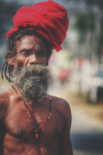 Close-up portrait of shirtless sadhu