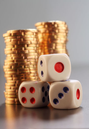 golden chips with dices Casino Golden Growth Market Stack Treasure Chips Coin Column Concept Dices Fortune Gamble Group Heap Investment Large Group Of Objects Many Metal Money No People Payment Pile Prize Success