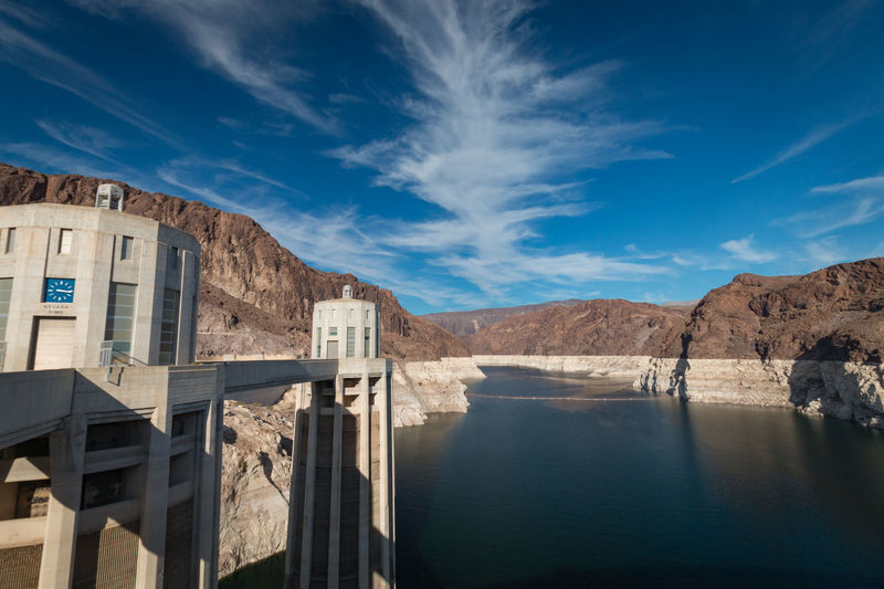 Hoover dam and lake mead with nevada time seen from nevada against cloudy sky