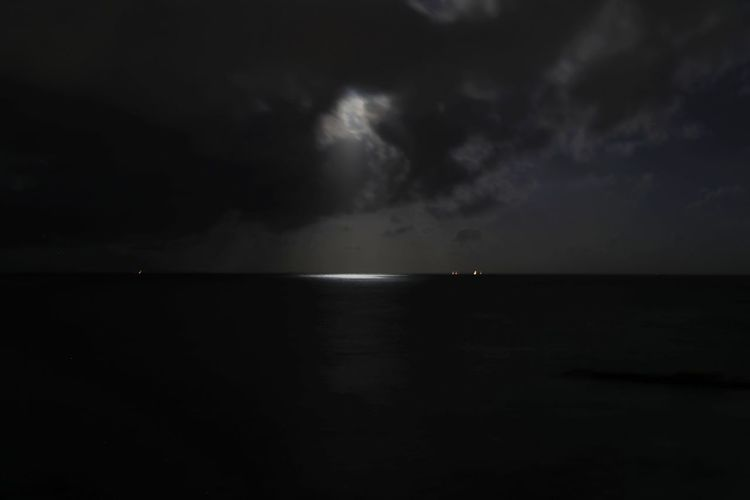 Beauty In Nature Horizon Over Water Moon Light Moon Lights Up The Night Nature Night No People Outdoors Scenics Sea Silhouette Sky Tranquil Scene Tranquility Water