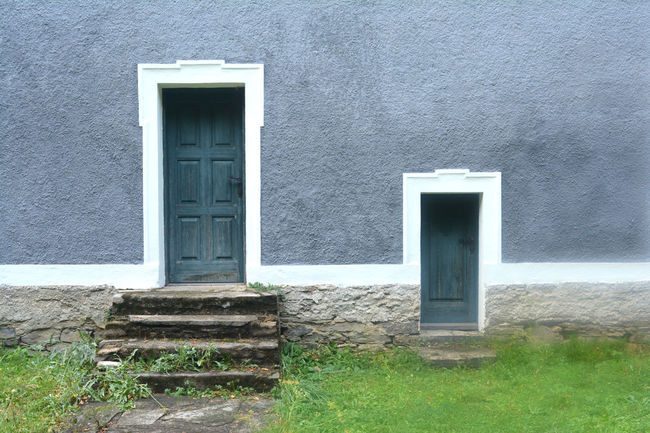 Architecture Building Building Exterior Built Structure Closed Day Door Doorway Entrance Grass Gray Green Color House Nature No People Outdoors Plant Residential District Wall - Building Feature Window