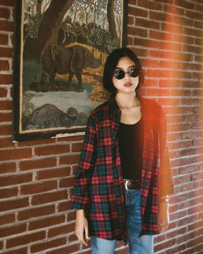 standing alone. EyeEmNewHere Brick Wall Adult People Only Women One Person Portrait Young Adult Fashion Stories