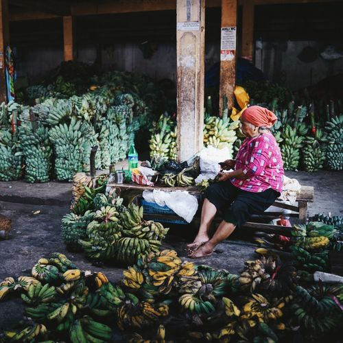 ASIA Bananas Day Fruits Green Bananas INDONESIA Indoors  Maluku  Market Old Woman Portrait Retail  Selling Selling Banana Sitting Ternate Traveling Woman Women Yellow Bananas The Portraitist - 2017 EyeEm Awards The Photojournalist - 2017 EyeEm Awards An Eye For Travel