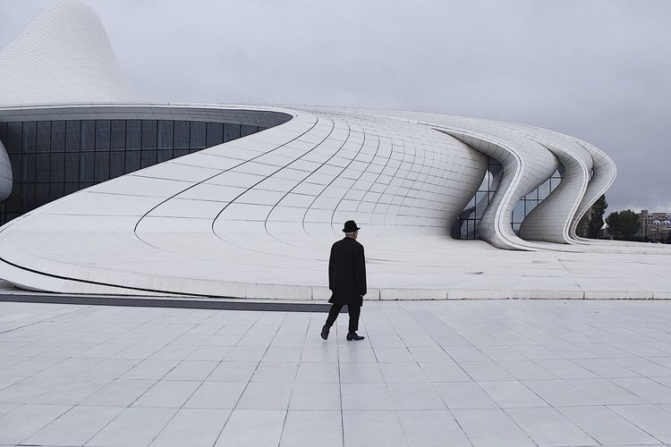 Rear View Of Man Walking Outside Heydar Aliyev Center Museum