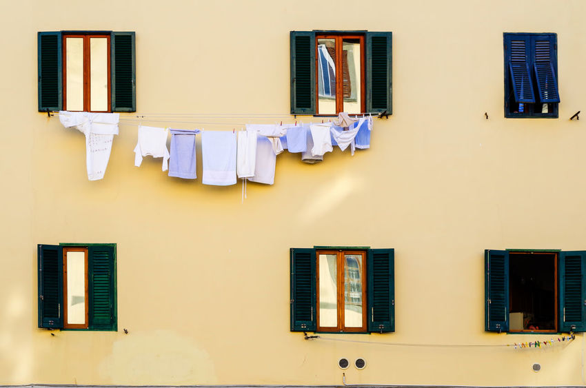 Full frame shot of Italian styled building exterior in Livorno, Province of Livorno, Tuscany, Italy. Venice - Italy Mediterranean Culture No People City Shutter Old Town Urban Scene Balcony Cultures Wall - Building Feature Europe House Façade EyeEm Selects Window Drying Architecture Building Exterior Hanging Day Outdoors Built Structure Clothesline Residential Building Yellow The Graphic City Colour Your Horizn Stories From The City Visual Creativity Adventures In The City The Architect - 2018 EyeEm Awards