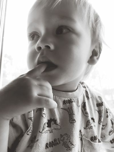 Close-up portrait of cute boy looking away
