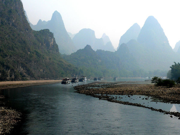 Guilin, China Amazing Mountains Amazing Place Amazing View China Fishing Bird China Photos China River Boats Fisching Bird Guilin Mountain Forrest Mountains River Sailboat Traveling In China