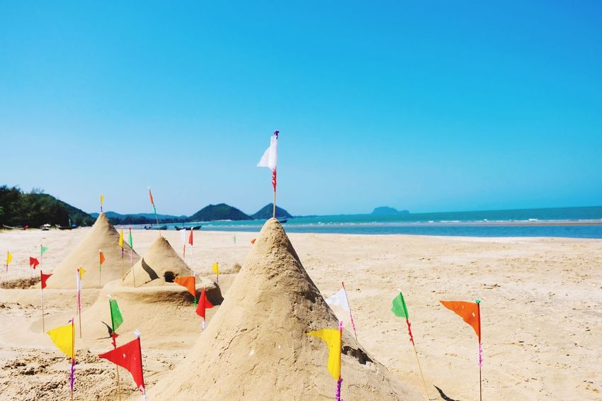 Beautiful sand mountain on the beach Landscape Clear Sea Water Blue Sky Holiday White Sand Sand Mountains Flag Beach Sea Land Water Sand Sky Nature Vacations Beauty In Nature Horizon Over Water Scenics - Nature Outdoors Incidental People Trip Holiday Sunlight Clear Sky Horizon Day Summer Exploratorium