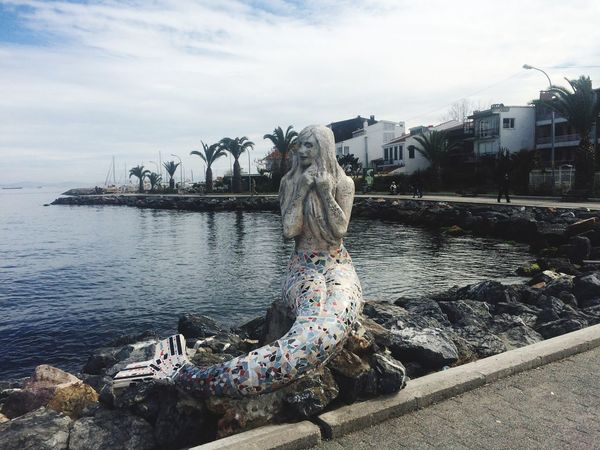 A mermaid waiting for the right ship to break away.. Water Sky Sculpture Statue Building Exterior No People Outdoors Island Turkey ♡ Istanbul Sunset Beauty In Nature Sea Princeislands seashore Mermaid EyeEmNewHere