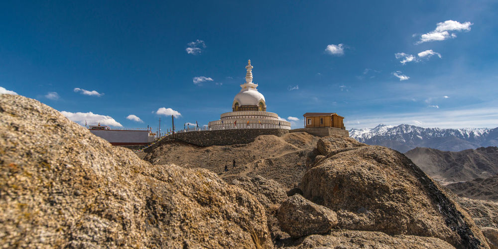 Low Angle View Of Temple On Mountain Against Blue Sky