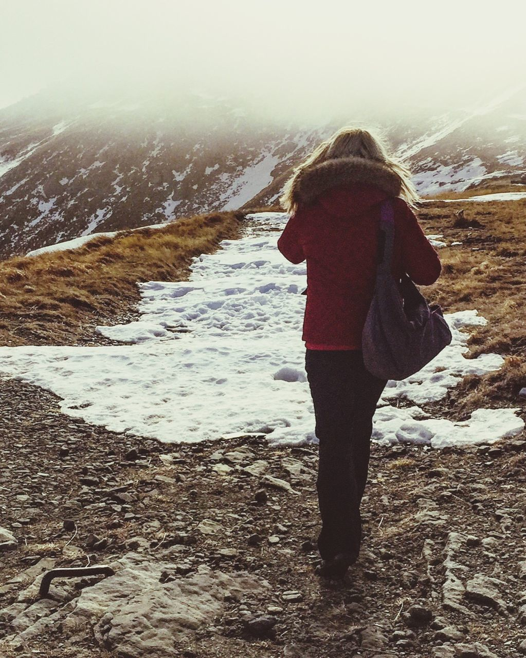 rear view, full length, winter, real people, nature, one person, leisure activity, standing, vacations, cold temperature, outdoors, lifestyles, beauty in nature, day, women, snow, landscape, beach, water, mountain, scenics, ankle deep in water, warm clothing, wave, sky, adult, people