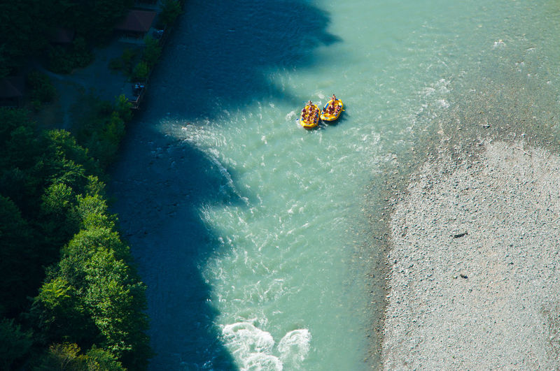 Aerial view of people sailing in river