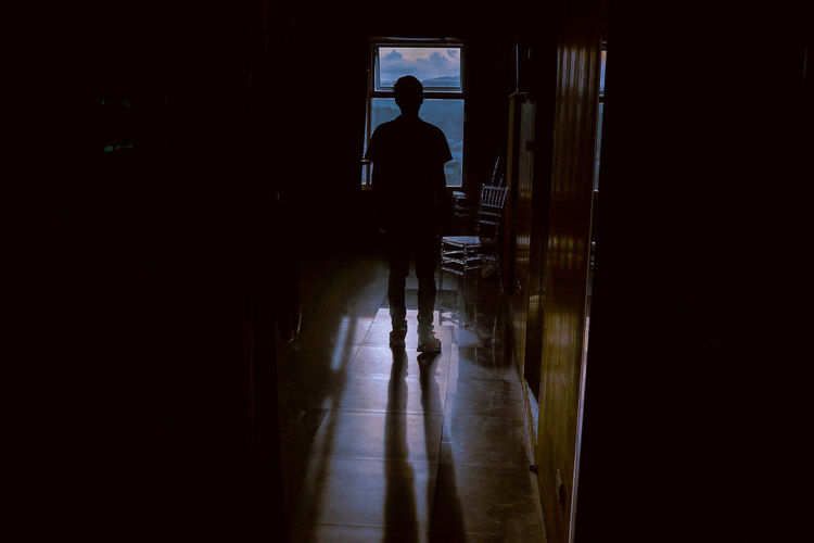 Indoors  Lifestyles Men One Man Only One Person Only Men People Real People Silhouette Standing