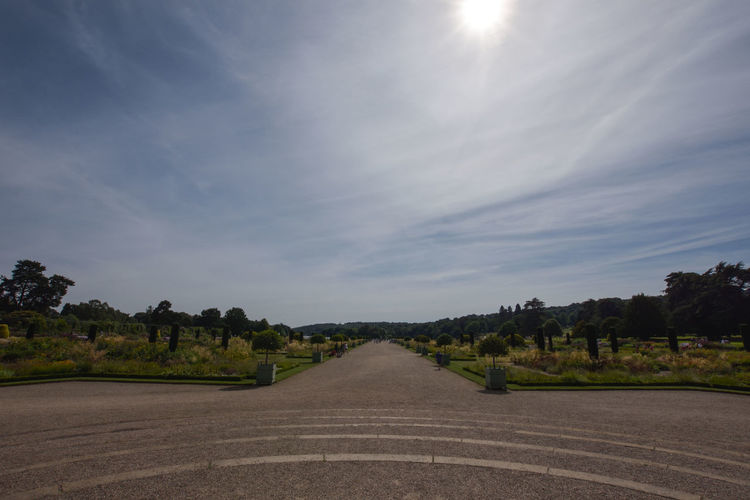 Pathway at trentham gardens against sky