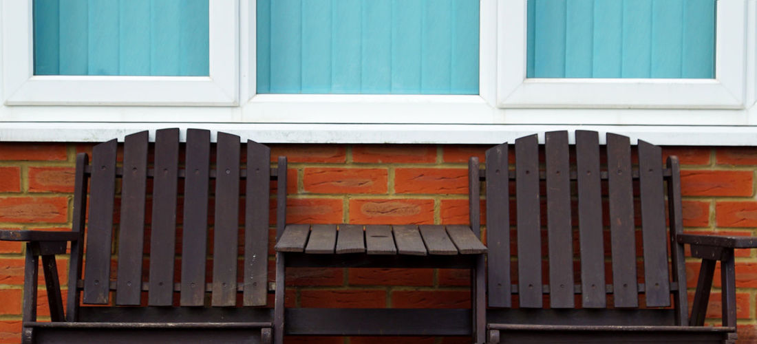 Adirondack chairs by house