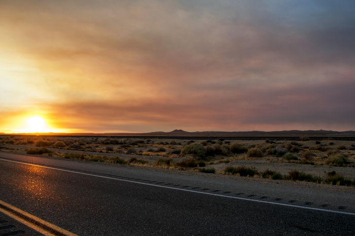 A sunset behind a sandstorm blowing past in the Mojave Beauty In Nature Cloud - Sky Day Landscape Mountain Nature No People Outdoors Road Scenics Sky Sunset The Way Forward Tranquil Scene Tranquility Finding New Frontiers Finding New Frontiers The Great Outdoors - 2017 EyeEm Awards Lost In The Landscape California Dreamin A New Beginning
