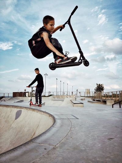 Air Leisure Activity Full Length Skateboard Park Skill  Real People Skateboard Sports Ramp Sport Lifestyles Stunt Childhood Balance One Person Boys Motion Mid-air Extreme Sports Sky IPhoneX Shotoniphonex מייאייפון10 מייסקייט מייספורט Be. Ready. Mobility In Mega Cities Go Higher Focus On The Story The Street Photographer - 2018 EyeEm Awards #urbanana: The Urban Playground
