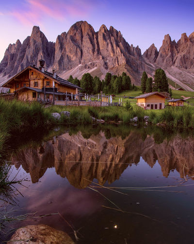 Light of sunrise 🌄 Mountain Reflection Landscape Outdoors Water Mountain Range Scenics Beauty In Nature Sunrise Moon Light Rose Color Mountain View Dolomites, Italy Trentino Alto Adige South Tyrol Rifugio Delle Odle Odle Group Val Di Funes