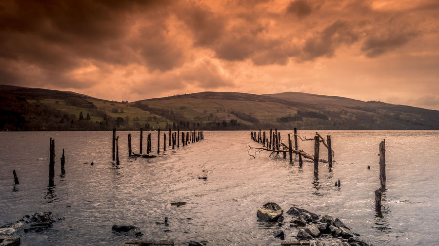 Water Mountain Cloud - Sky Sky No People Nature Scenics - Nature Beauty In Nature Tranquility Tranquil Scene Outdoors Mountain Range Wooden Post Dalerb Kenmore Loch Tay Scotland Landscape Long Exposure
