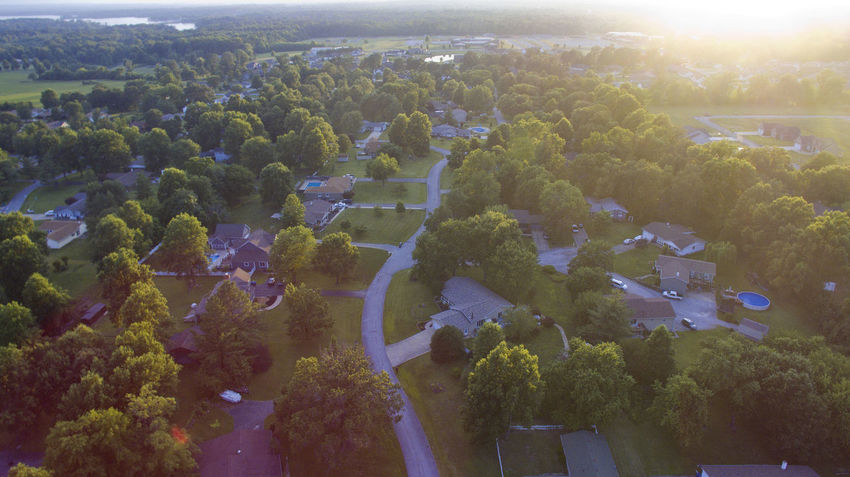 The sunsets over a small town neighborhood. Drone  Aerial Aerial View Agriculture Beauty In Nature Day Growth High Angle View Landscape Nature Neighborhood No People Outdoors Patchwork Landscape Rural Scene Scenics Sky Sunset Tranquil Scene Tranquility Tree