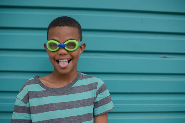 Star boy #NotYourCliche Boys Cheerful Childhood Close-up Day Elementary Age Front View Fun Green Color Happiness Headshot Lifestyles Looking At Camera One Boy Only One Person Outdoors People Portrait Real People Smiling Standing Striped Toothy Smile