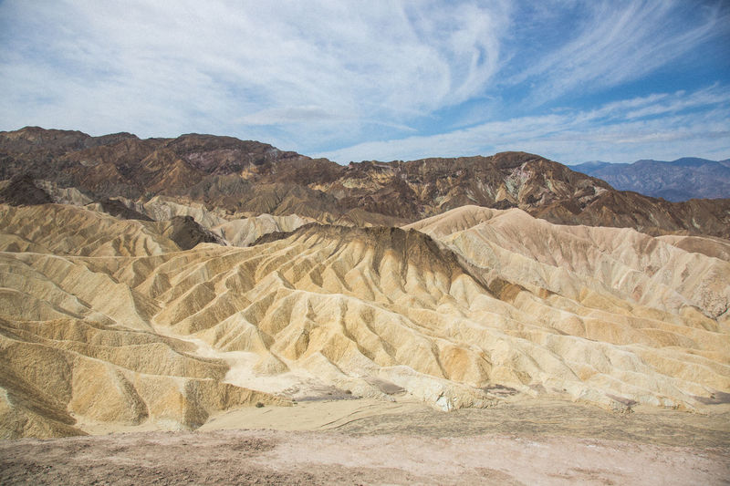 Zabriskie Point, Death Valley Barren Beauty In Nature Cloud Day Death Valley Desert Geology Idyllic Landscape Mountain Mountain Range Nature Non-urban Scene Physical Geography Remote Rock Rock - Object Rock Formation Rocky Mountains Scenics Sky Tranquil Scene Tranquility Travel Destinations Zabriskie Point