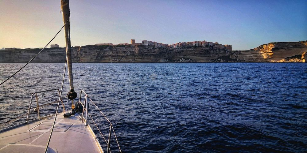 Corsica Cityscape Sailing Ship Sailing EyeEm Selects Landscape Cliff Seascape Water Sea Clear Sky City Nautical Vessel Business Finance And Industry Sky Boat Deck Sailor Sailboat My Best Travel Photo It's About The Journey The Mobile Photographer - 2019 EyeEm Awards The Traveler - 2019 EyeEm Awards