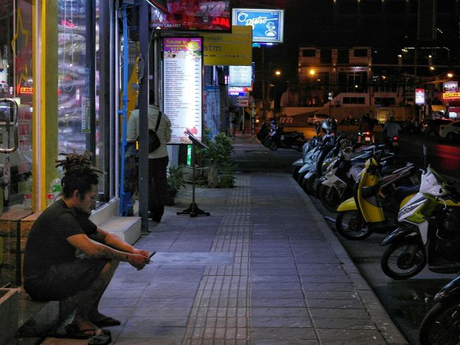 The Street Photographer - 2017 EyeEm Awards Night People Men Illuminated Outdoors Adult Real People One Person One Man Only City Sitting Outside Sitting Alone Phuket,Thailand Patong