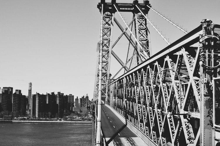 Bridge against sky in city
