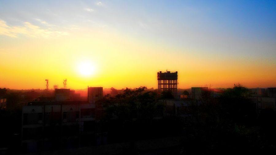 Peshawar city.... Amazing Pakistan Orange Sky Skyline Architecture City Cityscape No People Outdoors Peshawar Place Residential  Sky Sunset Towers Watertank Yellow