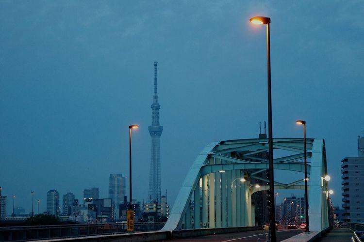 Eitai bridge in city against sky at dusk