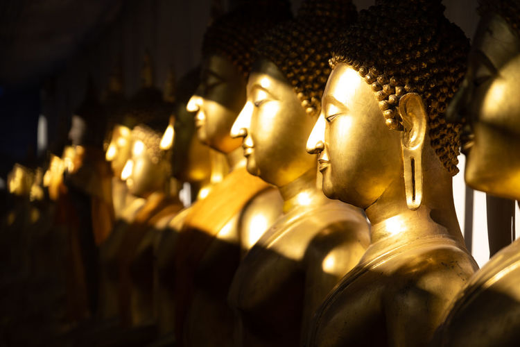 Belief Spirituality Sculpture Human Representation Statue Religion Representation Male Likeness Place Of Worship Art And Craft Gold Colored Creativity Architecture Built Structure No People Building In A Row Idol Thailand Buddha Buddhism Temple Gold Shiny
