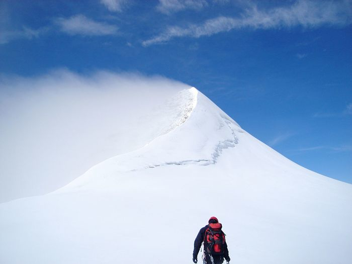 Man On Mountain Against Sky During Winter