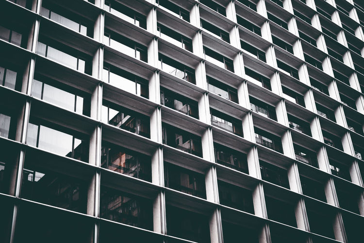 Apartment Architecture Backgrounds Building Building Exterior Built Structure City Day Full Frame Glass - Material In A Row Low Angle View Modern No People Office Building Exterior Outdoors Pattern Repetition Sunlight Window