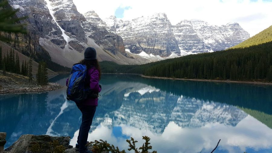 Rear view of woman standing on the edge of lake louise