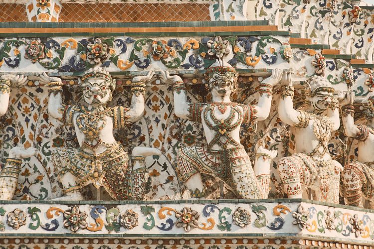 Wat Arun Temple Dawn Thailand Human Representation Art And Craft Representation Male Likeness Belief Architecture Creativity Religion Sculpture Built Structure History The Past Craft Spirituality Statue No People Travel Destinations Female Likeness Place Of Worship Building Ornate
