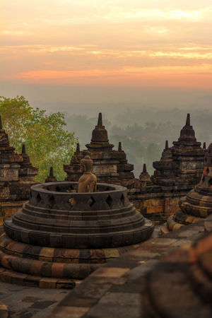 Photo from my recent trip to Borobudur temple, in Yogyakarta, Indonesia. Borobudur, is a 9th-century Mahayana Buddhist Temple. Built during the reign of the Sailendra Dynasty, abandoned following the 14th-century decline of Hindu kingdoms in Java and the Javanese conversion to Islam.A UNESCO World Heritage Site. Don't ever come here on raining season (like I did in Dec), most of the time just misty and cloudy. Would repeat the trip next year probably in April. Ancient Ancient Architecture Ancient Civilization Architecture Architecture_collection Beautiful Day Borobudur Borobudur Temple Buddhism Buddhist Temple EyeEm Indonesia Fredpius Historical Monuments Lord Buddha Magelang Sunrise Yogyakarta Landscapes With WhiteWall