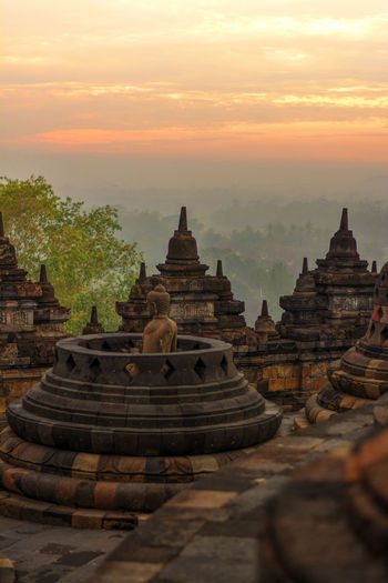 Stupas At Borobudur Temple Against Sky