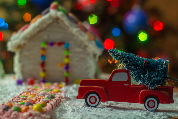 Close-up of toy car on christmas tree at night