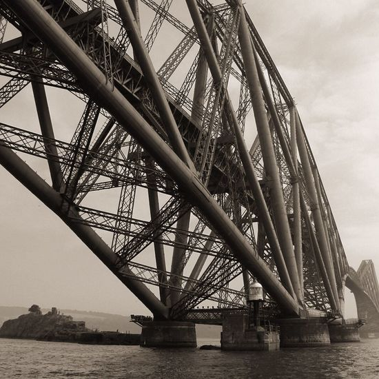 Forth Rail Bridge from the Sea, Black and White Built Structure Cable Connection Construction Development Engineering International Landmark Low Angle View Metal Metallic No People Outdoors Structure Technology ForthRailBridge Blackandwhite