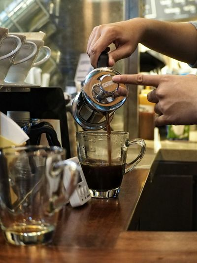 Close-up of pouring tea in cup