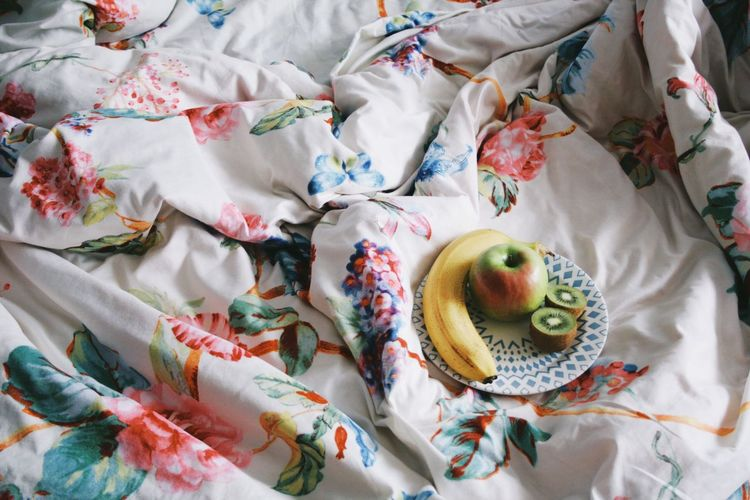 Fresh fruit High Angle View Still Life Textile Indoors  No People Bed Food Freshness Sweet Variation Sheet Sweet Food Dessert Choice Pattern Floral Pattern Food And Drink Multi Colored Furniture Close-up