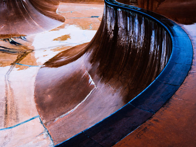 Abstract curves and colors of skateboarding training ground in rain Skatboarding Training Ground Abstract Curves Colors Lines Shapes Design Slopes Light And Shadow Rain Raining Wet Exercise Recreation  Outdoor Park Singapore Skate Skate Park