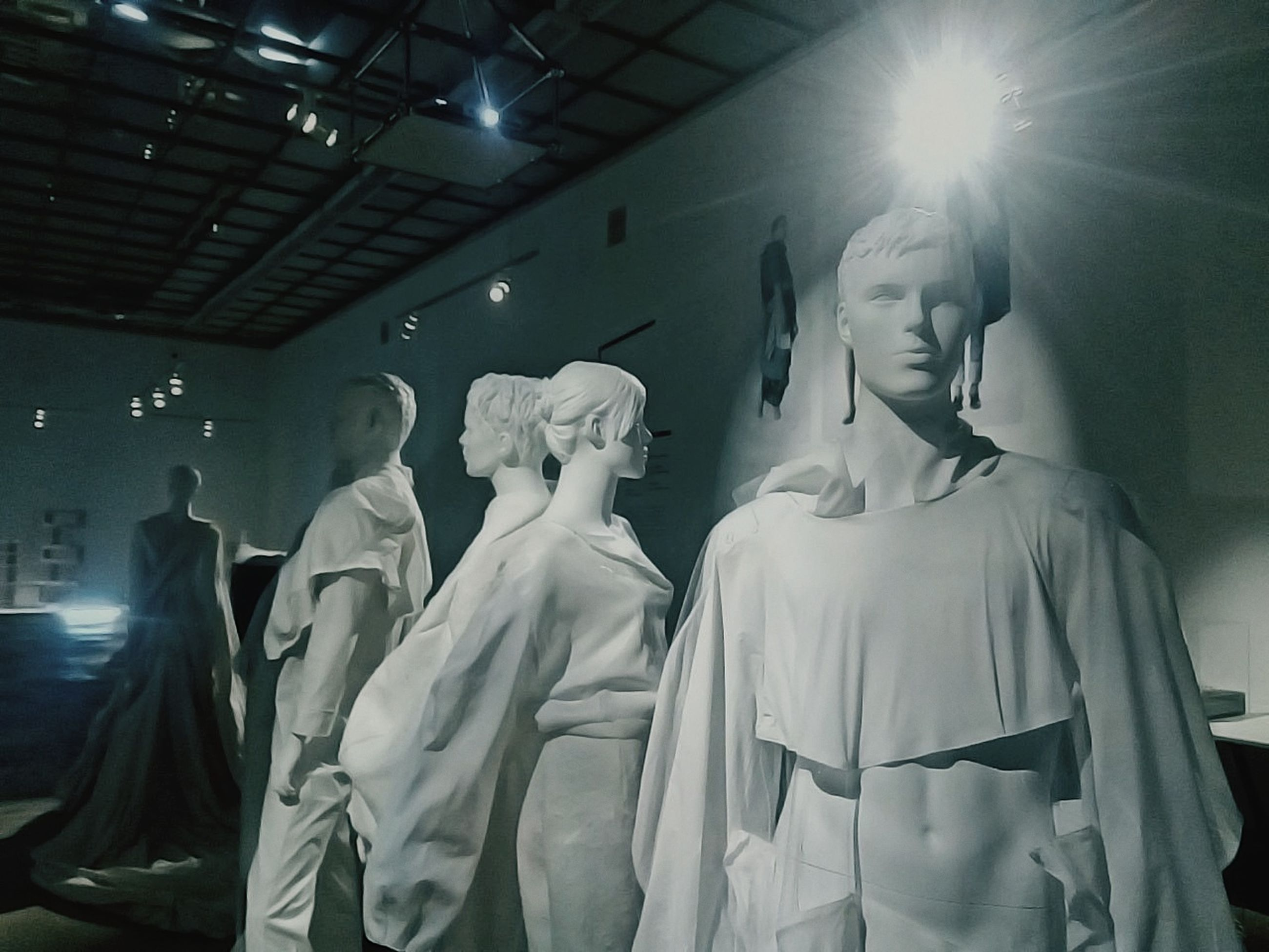 human representation, representation, art and craft, creativity, sculpture, indoors, male likeness, statue, architecture, female likeness, no people, lens flare, built structure, religion, mannequin, clothing, low angle view, craft, illuminated, spirituality, ceiling